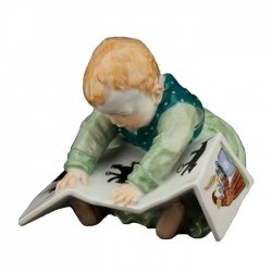 Child Sitting with Book
