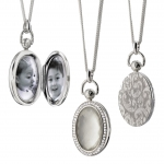 MOTHER OF PEARL OVAL POCKET WATCH LOCKET