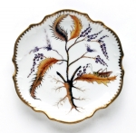 Thistle Bread and Butter Plate Discerning hostesses and porcelain enthusiasts have long coveted Anna Weatherley\'s exquisite hand-painted porcelain tableware featuring butterflies, bugs and botanical images.  Anna Weatherley was born in Budapest, Hungary.  Her artistic nature was nurtured by an environment filled with beautiful architecture, furniture, marble, ironwork and artwork of her native country.  