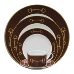 Cheval Chestnut Brown Five Piece Place Setting In a sleek twist on the iconic equestrian snaffle bit theme, Julie Wear takes it a step further to design a striking porcelain dinnerware collection of polished sophistication. Whether tail-gaiting at the polo field or setting an elegant table for a formal dinner party, Cheval presents a statement of classic high style and is sure to garner attention and admiration in both casual and formal occasions.